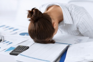 picture of woman sleeping at work in funny pose - pt