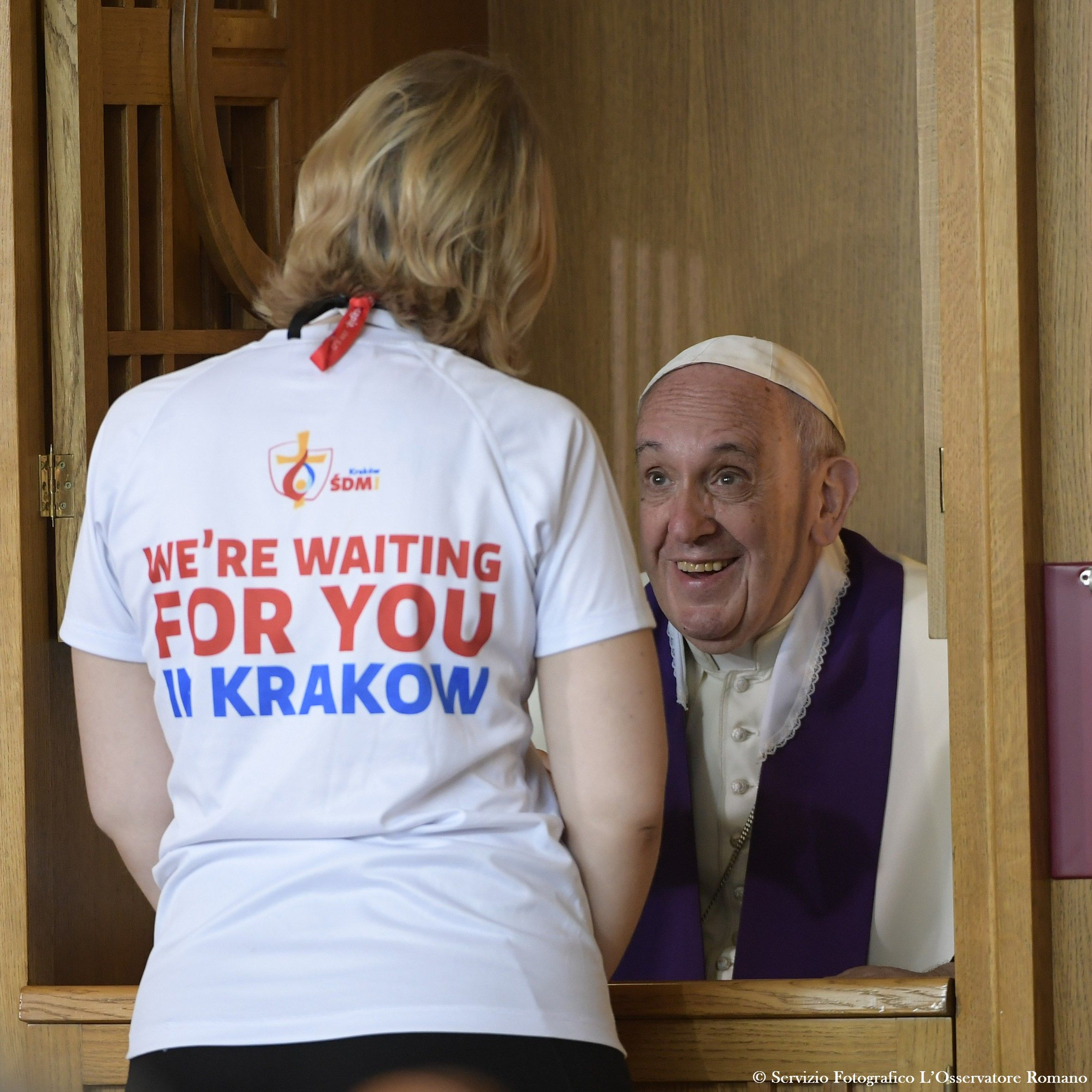 This handout released by Osservatore Romano shows Pope Francis confesseing a youth at the Divine Mercy Sanctuary on July 30, 2016 in Krakow-Lagiewniki as part of the World Youth Days (WYD). Pope Francis is in Poland for an international Catholic youth festival with a mission to encourage openness to migrants. HO / OSSERVATORE ROMANO / AFP