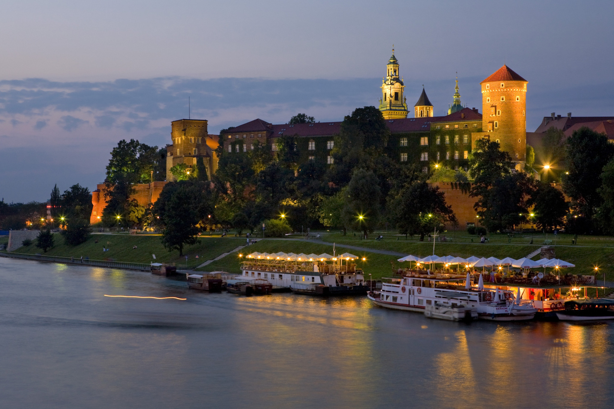 Wisla River and the Wawel Royal Castle at night, Krakow, Poland, Europe