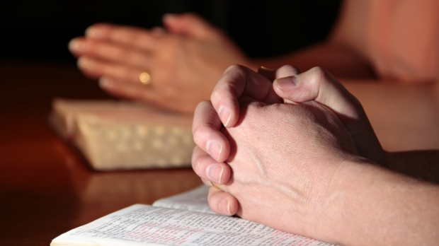 COUPLE PRAYING