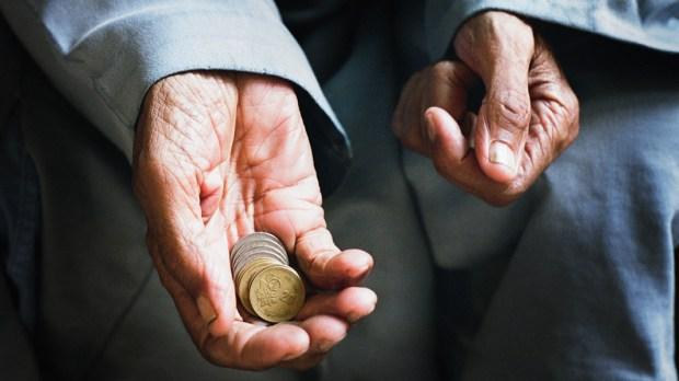 Old Man Holding Money
