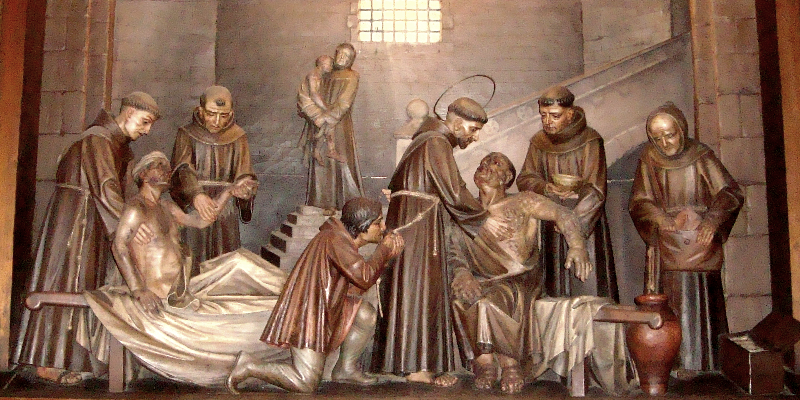 São Francisco cuida de leprosos - escultura no Santuário de Greccio