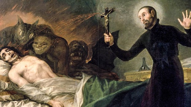 PRIEST PERFORMING EXORCISM