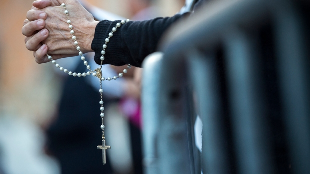 Woman Praying the Rosary