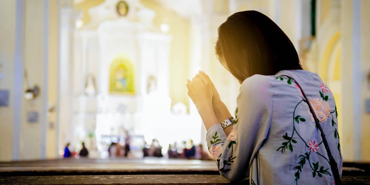 WOMAN KNEELING AT CHURCH