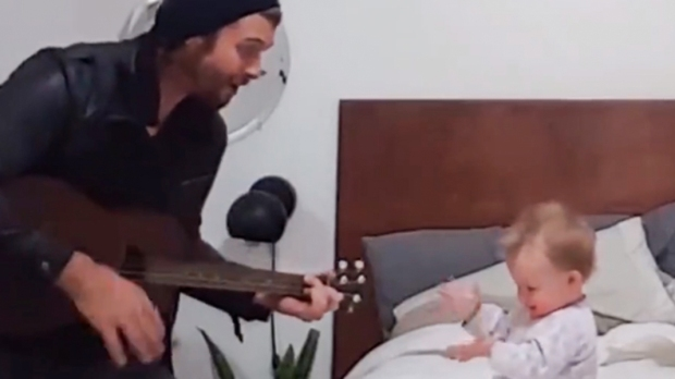 FATHER SINGING TO DAUGHTER
