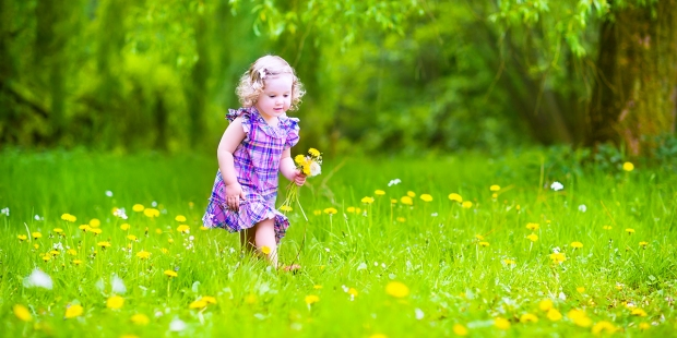 LITTLE GIRL PLAYING GARDEN