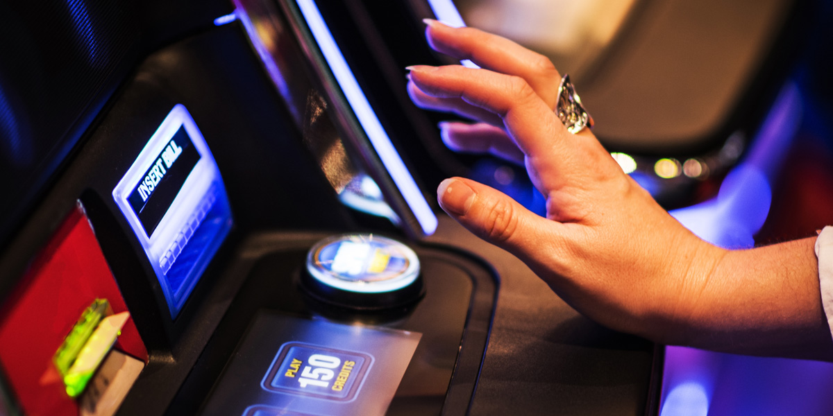 WOMAN,HAND,SLOT MACHINE
