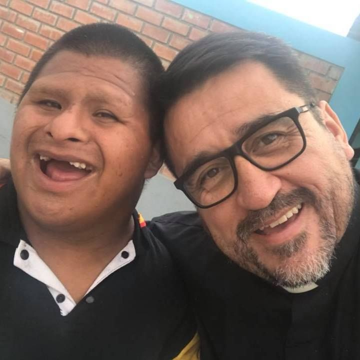 DOWNS SYNDROME,PRIEST
