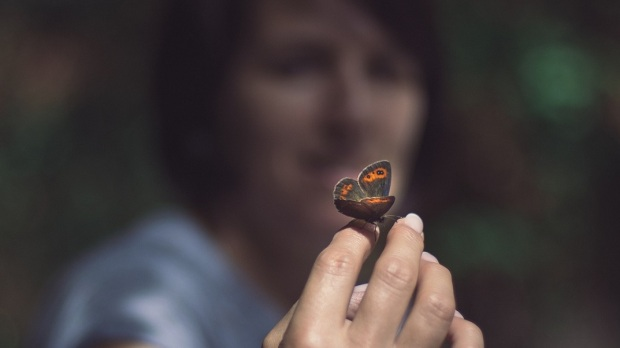 WOMAN WITH BUTTERFLY