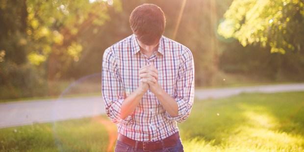 YOUNG,MAN,PRAYING