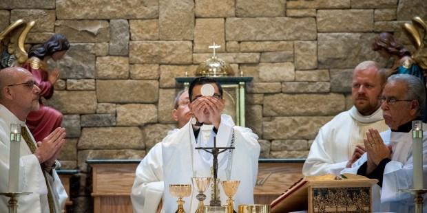 PRIEST,EUCHARIST,HOST,CONSECRATION