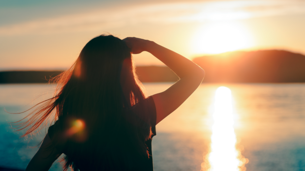 woman looking at the sunset