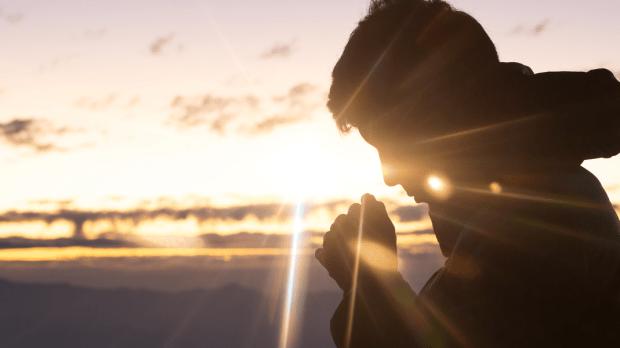 christian man hand praying