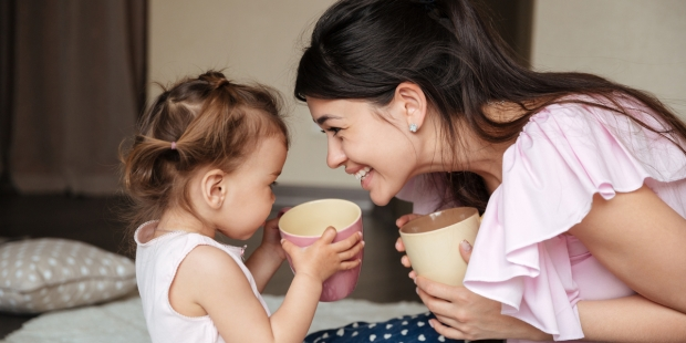 mother drinking tea with her daughter