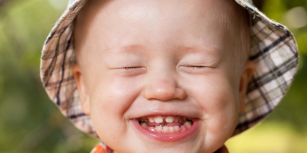 child smiles with teeth