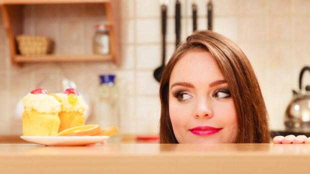 GREED-WOMAN-CAKE