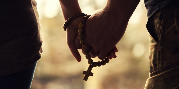 Couple Praying Rosary