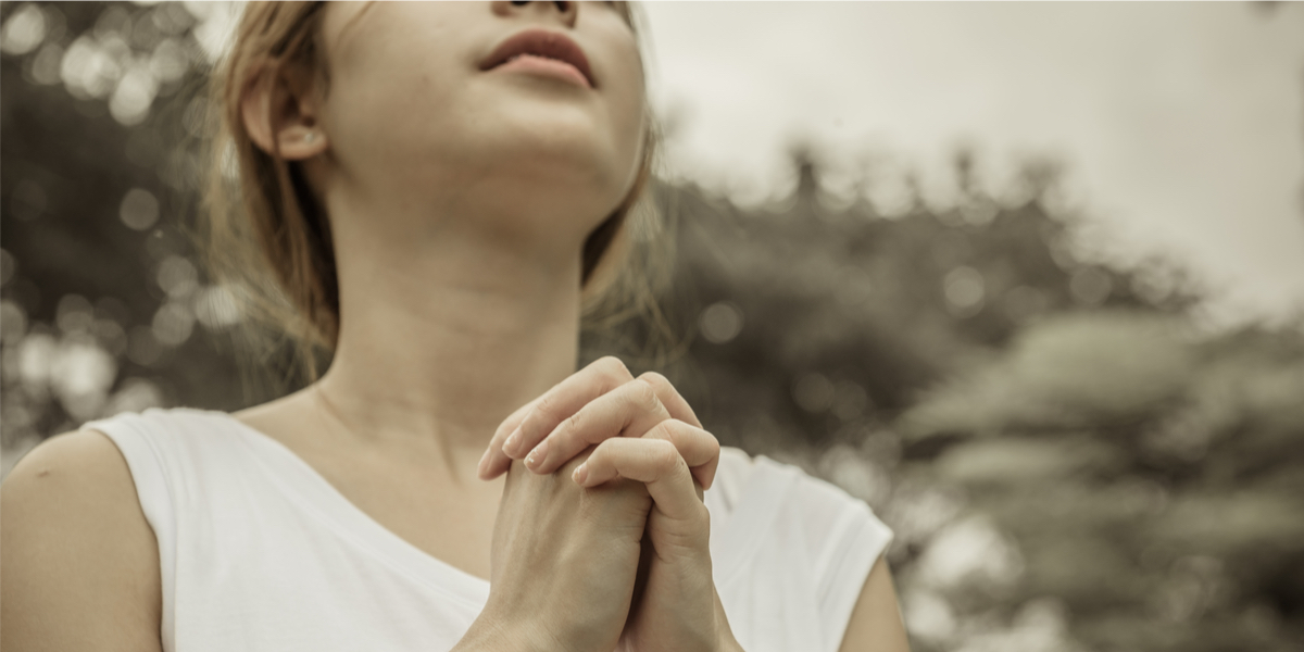 WOMAN, PRAYING,