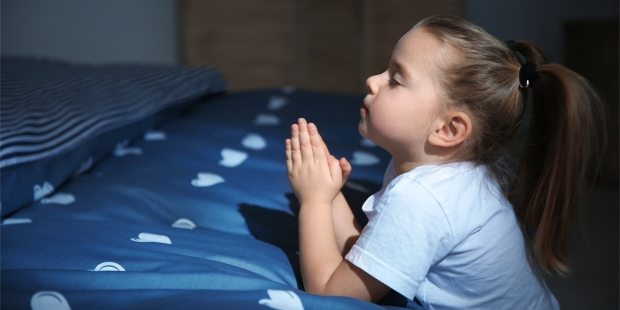 LITTLE GIRL PRAYING IN BED,