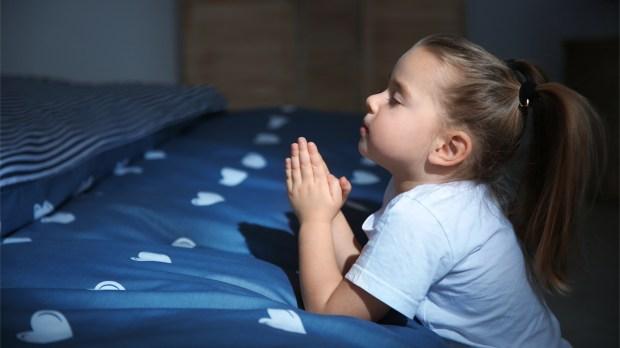 LITTLE GIRL PRAYING IN BED,