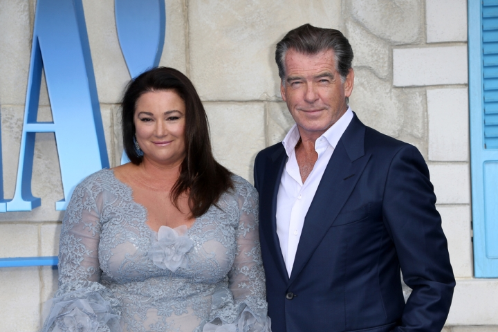 """London, United Kingdom- July 16, 2018: Keely Shaye Smith and Pierce Brosnan attend the UK Premiere of """"Mamma Mia! Here We Go Again"""" at Eventim Apollo in London, UK."""